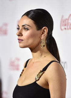Mila Kunis Ponytail - Mila Kunis slicked her hair back into a low ponytail for the CinemaCon Big Screen Achievement Awards.