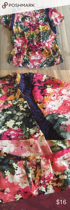 """Thyme and Honey Floral Blouse Top Short Sleeve L 🍃 Floral blouse accented in dark blue lace, slips over the head. """"V"""" design at the neck, curved hem. This can go from the office, to a pair of jeans on the weekend. Pretty floral design. Size large.   ▪️ Chest-40"""" ▪️ Length-27"""" 🍃🍃🍃🍃  ▪️ Fabric-Cotton/poly ▪️ Condition-Excellent pre owned condition ▪️ Non-smoking home  🍃Offers welcome 🍃 Thyme and Honey Tops"""