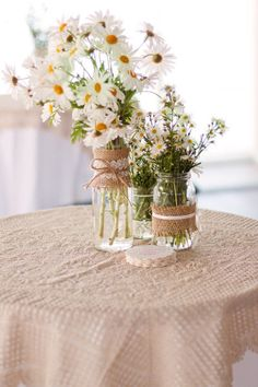 burlap and lace wrapped jar centerpieces
