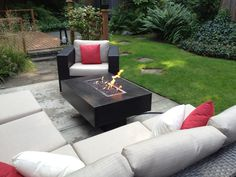 great patio with a concrete fire table