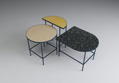 Marte Frøystad takes simple geometric forms and highlights them with different linoleum tops for the Flip It series of tables.