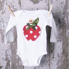 Polka Dot Apple Onesie, $24.99. Buy Now! Custom one of a kind baby baskets and cakes for newborns. Pregnancy Shower Gifts. Now offering next day hospital delivery! http://www.everythingandthebaby.com/