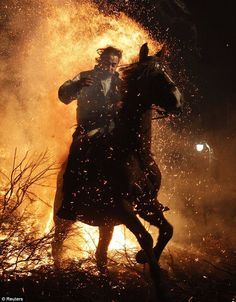 According to tradition, people from the area ride their horses through the fire to purify the animals