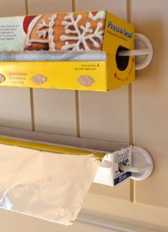 How to Organize Foil and Saran Wrap ~ using plastic hooks found at Walmart in the isle with the bathroom storage accessories by MarylinJ