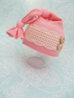 Newborn hat baby girl photo prop coral pink with lace and wood buttons newborn photography props. $19.00, via Etsy.
