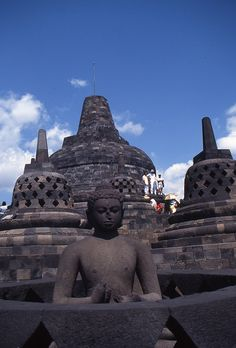 Buddha statue, Borobudur temple, Java, via Flickr.
