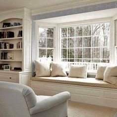What a pretty spot to curl up on this window seat. Beautiful sunshine coming through the bare windows. Classic Chic Home