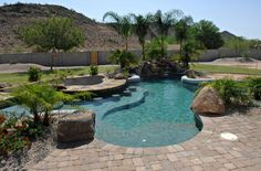 This natural #pool has baja steps, swim up bar, sunken #kitchen, and rock #waterfall. Gorgeous! http:/calpool.com