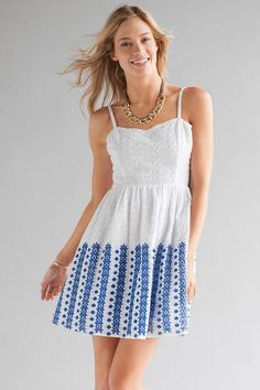 "Embrace+springtime+wearing+the+Biella+Eyelet+Dress!++This+white+cotton+dress+features+an+all-over+eyelet+design+with+blue+embroidered+eyelets+towards+the+bottoms.++Style+with+a+pair+of+sandals+&+sunglasses+for+a+sunny+spring+day.+<br><br>  -	34""+length+from+shoulder+to+hem+<br>  -	34""+chest<br>  -	Measured+from+a+small<br><br>  -	100%+Cotton+<br>  -	Machine+Wash<br>  -	Imported<br>"