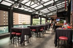 Carolina Ale House, Raleigh North Carolina. FSRS installed a Libart Solaglide Skylight retractable roof and the first North American installation of Panora View windows. Stoett retractable solar screens filter the sun's glare.