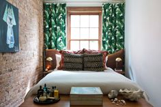 Tiny bedroom with jungle leaf curtains Small Rooms, Small Apartments, Leaf Curtains, Bedroom Curtains, Bold Curtains, Tropical Curtains, Brick Bedroom, Large Curtains, Patterned Curtains