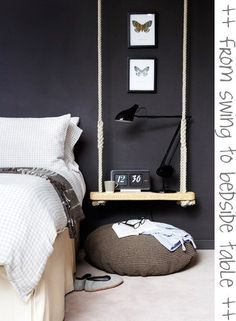 blog68 Love the bedside table swing.  Makes the perfect end table.  Modern sleek bedroom with personality. Black accent wall creates an impromptu headboard.