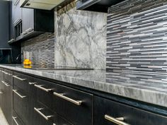 Super white marble countertops atop dark wood cabinets accented with tile backsplash White Shaker Kitchen Cabinets, White Marble Kitchen, Dark Wood Cabinets, Black Cabinets, White Quartzite Countertops, Stainless Backsplash, Kitchen Countertops, Granite, Kitchen Backsplash