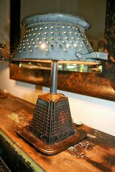 Vintage stovetop toaster and colander repurposed. (I actually bought a stovetop toaster by accident when I was collecting graters! Vintage Toaster, Vintage Stove, Vintage Kitchen, Diy Luz, Luminaria Diy, Recycled Lamp, Diy Luminaire, Polished Pebble, Trash To Treasure