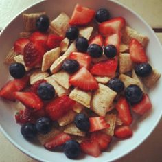 Breakfast...mini wheats with strawberries and blueberries;)