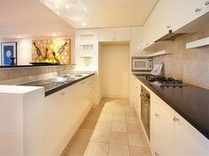 Photo Of A Modern Galley Kitchen Using Granite From The Kitchen Image  Galleries   Kitchen Photo Browse Hundreds Of Images Of Modern Kitchens U0026  Photos Of ... Part 85