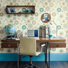Retro walls home office  A vibrant wallpaper pattern is a great way to zone out a home office area when you don't have the luxury of an extra room, simply paper the wall behind the desk. Here, contemporary wooden furniture goes perfectly with the brown circles in the wallpaper. A floating shelf is ideal for keeping books and stationary out of the way