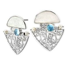 Donna Chambers Gambling Chip and Blue Topaz Earrings. We carry the complete collection of jewelry designer Donna Chambers hand made antique mother-of-pearl gaming chip jewelry. Each one-of-a-kind piece of jewelry is perfect for those that want to wear the extraordinary! Visit Renaissance Fine Jewelry in Vermont. www.vermontjewel.com