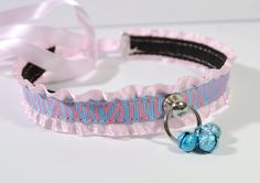 Pink & blue ribbon collar w/ three sparkly blue bells.  Ties in back, but could easily have rings attached to make it lockable.  $18