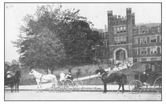 """Wow!  1908  The final section of the """"Old Main"""" building at Marshall College (now Marshall University) just after completion in 1908. This view from Sixteenth Street (now Hal Greer Blvd), shows the distinctive Old Main towers that have now become the university's trademark. The school has been on this site, in one form or another, since 1837. Courtesy MU official online history."""
