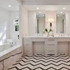 Happy ‪#‎WZWednesday‬, design friends. We could certainly handle waking up to this every morning! This spectacular master bath, designed by KCS Estates, features our Sterling Row, Tuxedo pattern on the floor.  http://bit.ly/1qpZAEg