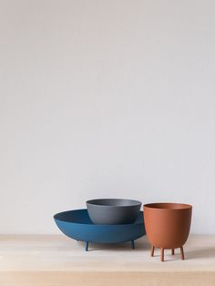 Pin bowls are a set of decorative multi-purpose containers to keep everyday objects. The group includes three bowls with friendly round shapes and delicate legs that elevate them off table and counter tops. Pin bowls are available in selected colours: Small – Dark blue / Medium – Clay grey / Large – Red terracotta