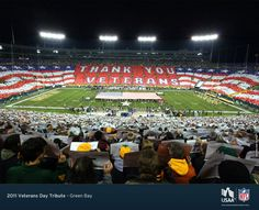 Green Bay Packers fans honor veterans and current service members during the National Anthem at the Packers game on Monday, November 14, 2011 in Green Bay.