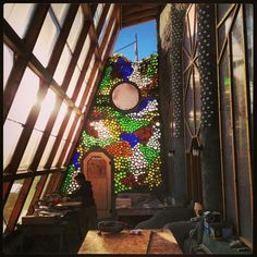 Beautiful recycled glass wall with Earthship Biotecture