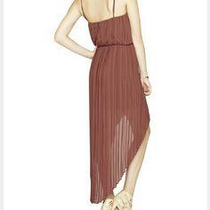 NWT BCBG burgundy pleated dress Brand new BCBG generation dress.  Burgundy pleated hi-low with adjustable spaghetti straps.  Dress up or down! Machine washable. ..retail price $148!! BCBGeneration Dresses