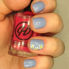 pastel blue spring nails with hand painted daisies