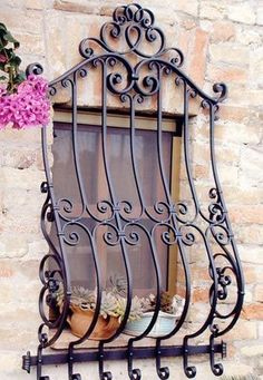Iron Window often guard the windows of apartments and offices, located on the demean levels of buildings. This solution significantly improves the security. Many people locate burglar bars unattrac… Window Pane Mirror, Window Bars, Iron Window Grill, Window Grill Design, Wrought Iron Decor, Wrought Iron Gates, Iron Wall Decor, Iron Windows, Iron Doors