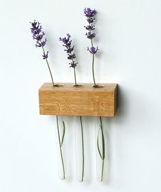 DIY Flower Holder - Take a wooden block, drill in three holes and put in test tubes. Easy, affordable and beautiful! #diy