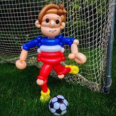 Soccer player balloon twist