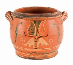 "Realized Price: $ 15,405   Pennsylvania redware two-handled jar, early 19th c., with vibrant yellow and green tulip decoration, the handle terminals with punched stars, 6 1/4"" h., 8 3/4"" w. The Collection of Lester Breininger"