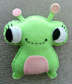 Green wide eyed felt monster stuffed animal It's cute