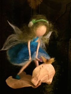 Hey, I found this really awesome Etsy listing at https://www.etsy.com/listing/226174443/needle-felted-fairy-with-butterfly