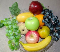 These fruits look lovely and in good condition. Fruit bowl includes Grapes, apples, banana's.