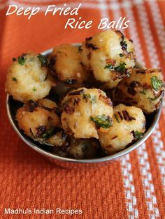 deep fried rice balls - a quick evening snack made with cooked rice, rice flour, onion and green chilly. serve the deep fried rice balls with some ketchup and coffee.