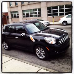2012 Mini Cooper Countryman in black with white and checkers. Yessss