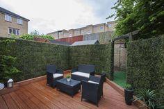 Jardines de estilo moderno de Millennium Interior Designers