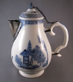 Blue & white chocolate pot with silver repairs, c.1750 via Past Imperfect: the art of inventive repair.