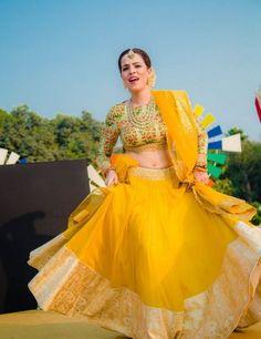 Let this outfit make your fashion statement..Stunning Lengha by Pareesa Boutique..Rich Yellow color Thread embroided net lengha fabric, with Pink raw silk.    #lehenga #yellowlehenga #designerlehenga #womenlehenga