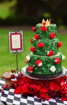 """Queen of Hearts """"painting the roses red"""" cake for an Alice in Wonderland wedding"""