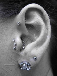 triple tragus #piercing ♥ reminds me of @Molly Sullivan