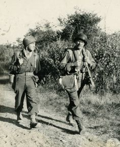 WWII medic and solider march along Burma Road while sharing stories. Photographer Unknown.