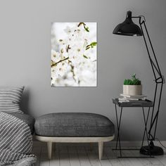 White tree blossoms Poster made out of metal. White tree blossoms wall art is showcased in interior by ARTbyJWP via Displate #homedecor #walldecor #artprint #shop #displate #decoration #blossom