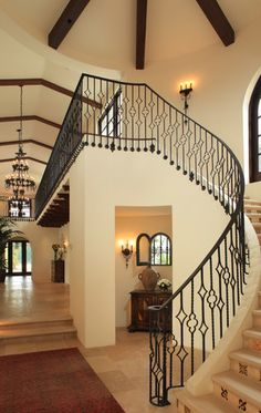 View down the gallery with wrought iron chandeliers. Light ivory wall color virtually identical to ours.