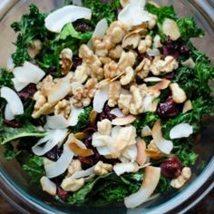 Wilted Kale and Coconut Salad.... Ingredients:  1 bunch of curly leaf kale  1/2 cup unsweetened coconut flakes  1/3 cup raw walnuts  1/4 cup dried cranberries  Olive oil