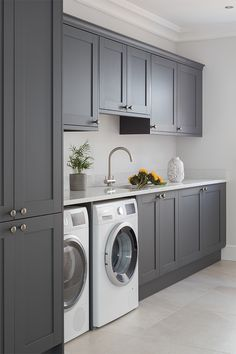 Create a dark grey shaker kitchen with white worktops to create a dark contemporary kitchen. Add classic details like a kitchen mantle to create a cosy kitchen. Masterclass kitchens are available across England, Wales, Scotland and the Channel Islands Small Laundry Rooms, Mudroom Laundry Room, Laundry Room Layouts, Laundry Room Organization, Laundry Room Remodel, Laundry Room Ideas Garage, Laundry Room With Storage, Laundry Room Counter, Laundry Room Cabinets