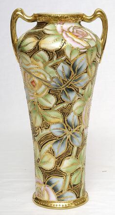 "Nippon Moriage Vase: Moriage, a style of decoration used by porcelain manufacturers during the late 1800s/early 1900s. It is the art of laying ""beads"" of porcelain on the item prior to firing in the kiln - later gold was applied."